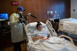 Oscar Guerra films Zully in her hospital bed